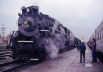 The 765 getting ready to pull a hopper train, as its crew looks on