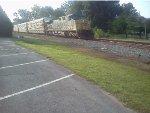 CSX 518 leads an autoreack train through Kingston, Ga.