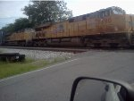 UP 7390 and UP 7764 lead a doublw stack container train in Emerson, Ga.