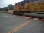BNSF 8842 serves as a helper unit on a Georgia Power Plant Scherer train