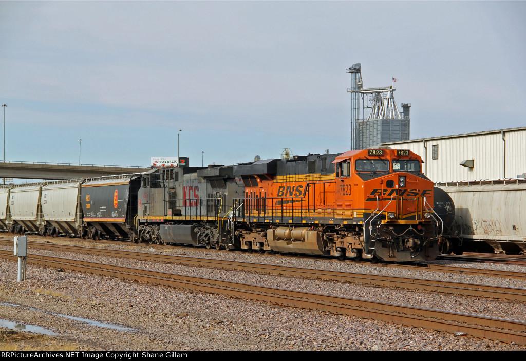 BNSF 7823 & KCSM lead this EB grain train.