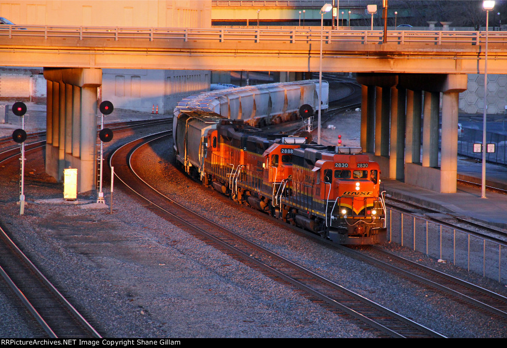 BNSF 2830 Heads this WB cement city local into the setting Sun.