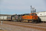 BNSF 7823 & KCSM lead this EB grain train.