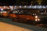 BNSF 7913 Leads a WB Q train past Kc Union station.