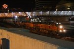BNSF 7154 Heads up a Q train past Union station.
