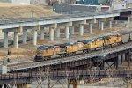4 Unit's power a empty coal train across the flyover.