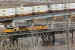 UP 6900 Leads a grain train EB on the KCT Bridge.