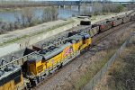 UP 8847 Brand new heavy leads a EB freight in the bottoms.