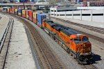 BNSF 7860 Heads up a stack train..