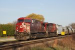 CP 9721 leads a sister on CP 288 into the bright morning sun