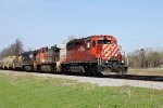 CP 5926 fronts a cool lashup on eastbound unit grain train 390