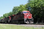 CP 8766 leads an eastbound unit train approaching Bowman Road