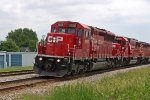 CP 5006 flies through leading an all-red, all standard cab EMD lashup on 633