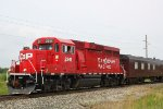 CP 2241 scans the tracks with its short hood-mounted camera as it leads the TEC train west