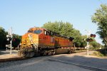 The light engine BNSF 4347 running as train 674 follows 687 west across County Highway N