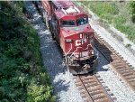 CP 8861 about to dive under the Sauer Road bridge with EB oil train 580