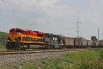 KCS 4125 and NS 6163 lug CP 287 slowly westward along the siding