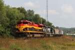 KCS 4125 with CP train 287 strung out behind