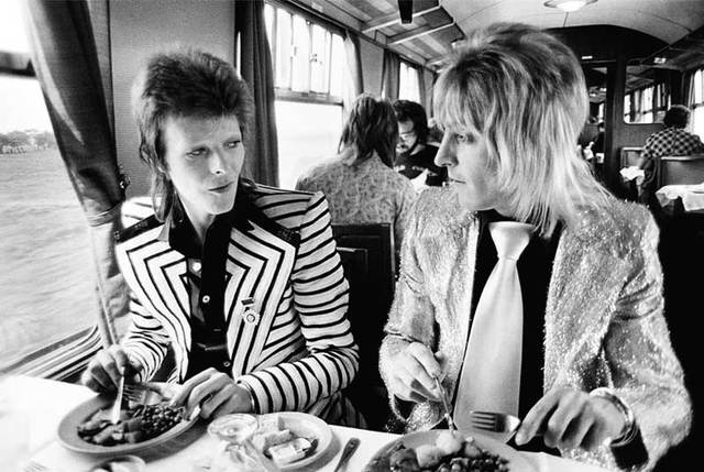 David Bowie & Mick Ronson, Train to Aberdeen, 1973. Photograph by Mick Rock, courtesy of Blender Gallery