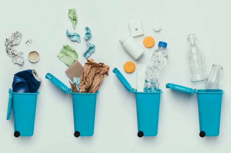 top view of trash bins and assorted garbage isolated on grey, recycle concept
