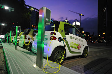 Electric cars charge at charging station