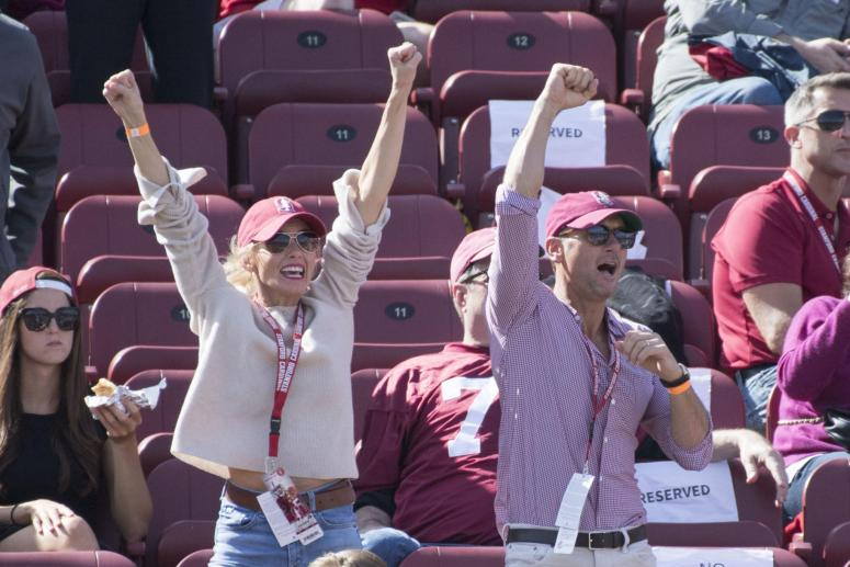 Tim McGraw and Faith Hill cheering on sports