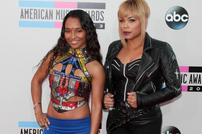 Chilli and T-Boz of TLC arrive at the 2013 American Music Awards held at the Nokia Theatre L.A. Live in Los Angeles, CA on November 24th, 2013.