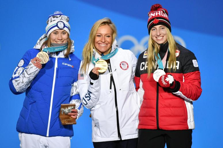Feb 12, 2018; Pyeongchang, South Korea; Silver medalist Laurie Blouin (CAN), left, poses for a photo with gold medalist Jamie Anderson (USA), center, and bronze medalist Ennie Rukajarvi (FIN) during the medals ceremony for the ladies slope side snowboard