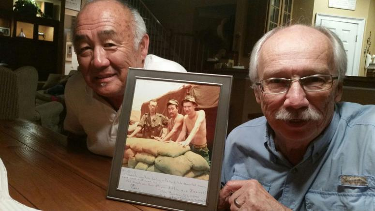Rodney Fujita (l) father of former NFL star Scott Fujita, with stand-up comedian Pete Burdon (r) . The two served together with the Marine Corps in Vietnam and are at center and right in the inset picture taken in Vietnam