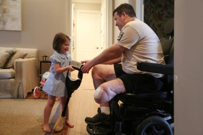Kids are caregivers too: For Sarah and Michael's daughters, helping their dad is a part of every day life.