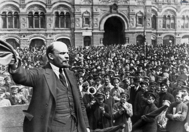 Lenin returns from exile and arrives in Petrograd via a sealed train