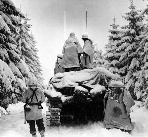 Battle of the Bulge, the last German offensive, begins in a frigid northern European winter