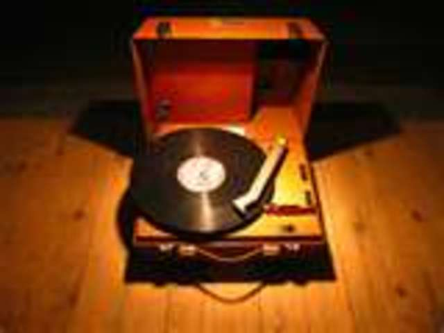 1941-1950   Electrical Computer, 45 rpm record, poloroid land camera, and 33 1/3 pm record
