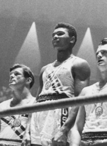 Muhammad Ali wins the gold medal in Summer Olympics