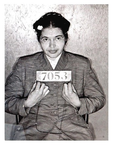 Rosa Parks is arrested for violated Montgomery's bus laws