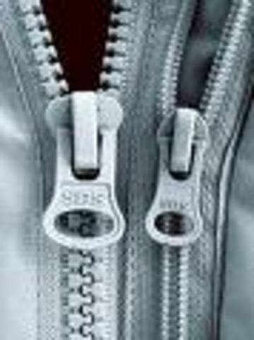 American, W.L. Judson invents the zipper.