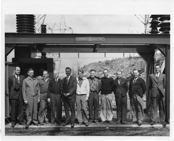 General Electric employees pose for photo following a test of Dam circuit breakers