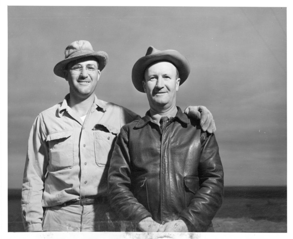 Howard A. Hales and A.L. Hales pose for photo on adjoining farms on Columbia Irrigation Project lands