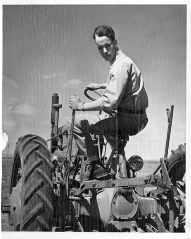 Warren Clifford, the first settler on the Pasco Unit, drives his tractor over his land to prepare for irrigation waters
