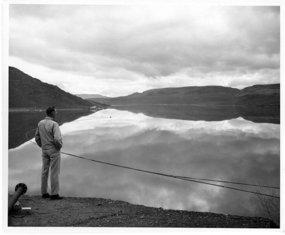 Photographer H.W. Fuller looks over Lake Roosevelt behind the Grand Coulee Dam