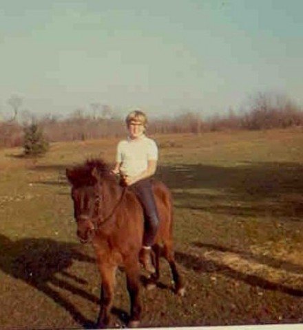 Liz gets on a horse-make that pony