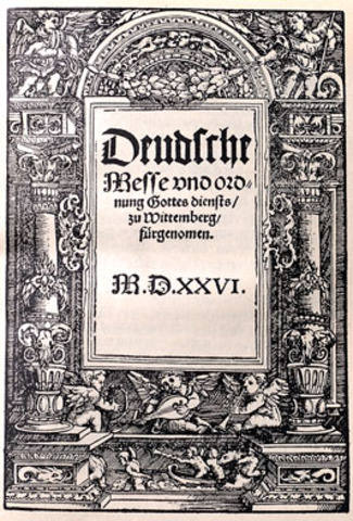 Martin Luther starts using German language in the mass