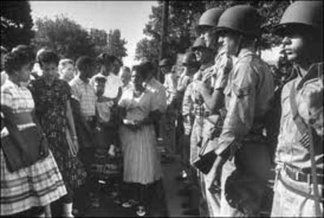 The Little Rock Nine try to enter the school, met my mob