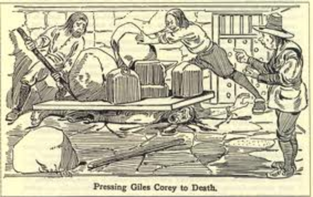 Giles Corey pressed to death