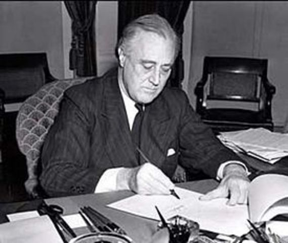 President Roosevelt signs the Lend-Lease Act