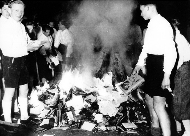 Public burning of books written by Jews, political dissidents, and others not approved by the state