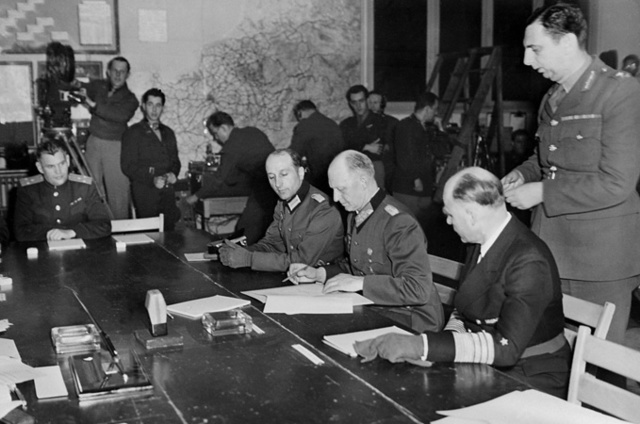 Hitler openly announces to his cabinet he will defy the Treaty of Versailles