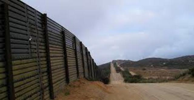A bill to build a 700 mile fence along the Mexican border is signed