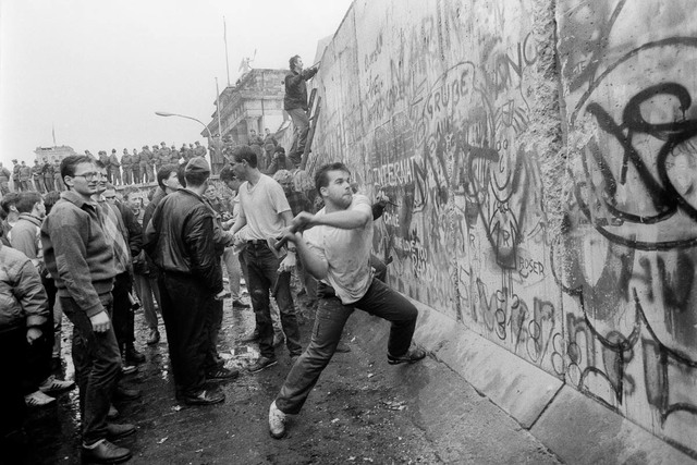 The Berlin Wall is knocked down