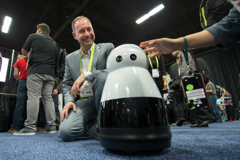 Mike Beebe, of Mayfield Robotics, shows off Kuri the company's home robot at CES Unveiled Las Vegas at the Bellagio Convention Center.